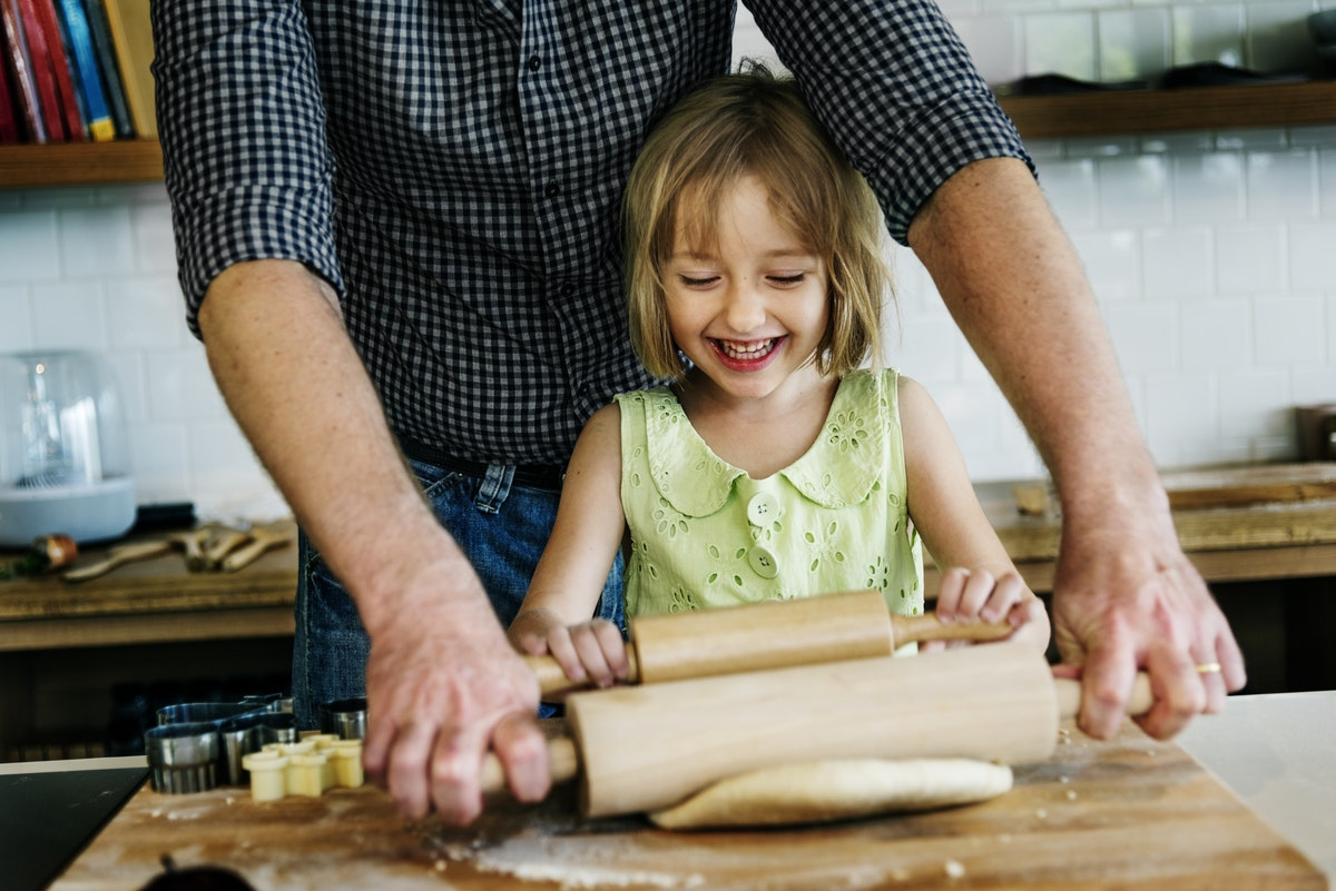 Gentle parenting: Dad cooks with his daughter